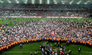 Reims fans celebrate after their promotion to Ligue 1.