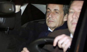 Former French President Nicolas Sarkozy leaves the the financial section of Paris court house after questioning.
