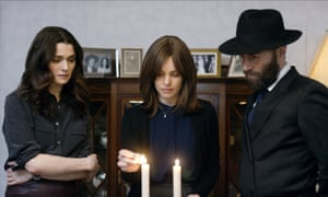 Rachel Weisz, Rachel McAdams and Alessandro Nivola in a scene from Disobedience.