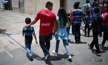 Undocumented immigrant families walk from a bus depot to a respite center after being released from detention in McAllen, Texas.