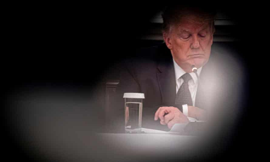 Donald Trump reveals that he is taking hydroxychloroquine against Covid-19 as he participates in a roundtable with business leaders at the White House on 18 May.