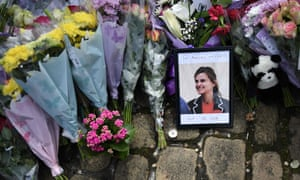 A photo of Jo Cox sits among floral tributes in Birstall where she was killed.