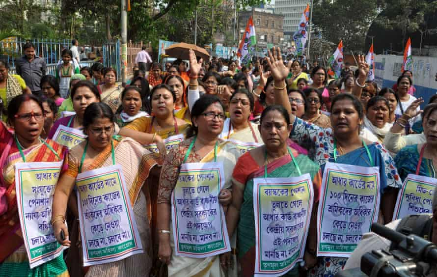 Activists protest in Kolkata against the Indian government's decision to link free lunch meals for children with the national the Aadhaar ID card.