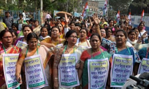 Women in Kolkata protest against the linking of the Aadhaar cards to free school lunches