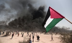 Palestinians stage a demonstration at the Great March of Return near the Gaza/Israel border in 2018.