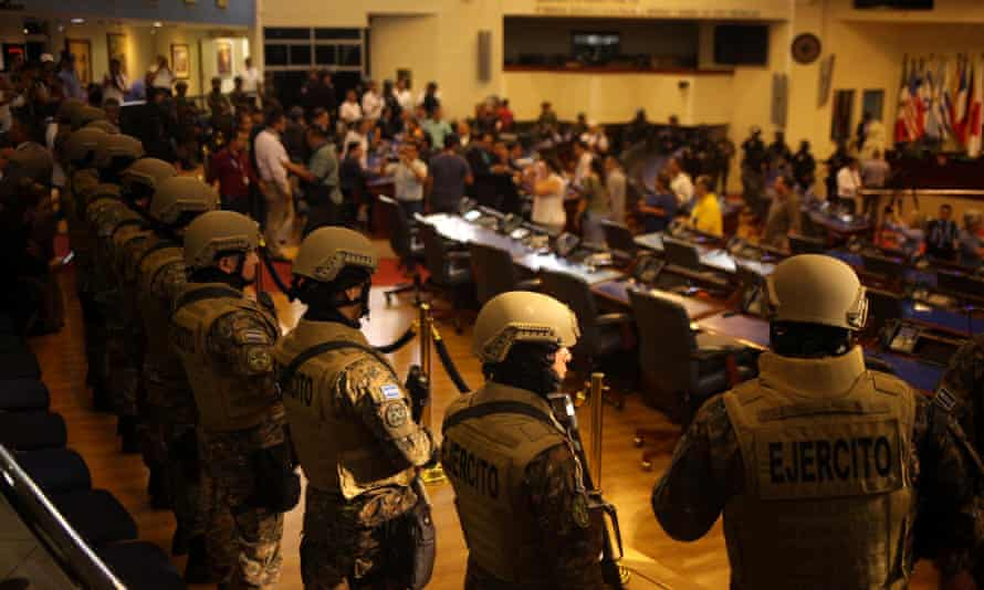 Soldiers stand inside El Salvador's national congress as President Nayib Bukele addresses a special session to push for the approval of funds for a government security plan on 9 February.