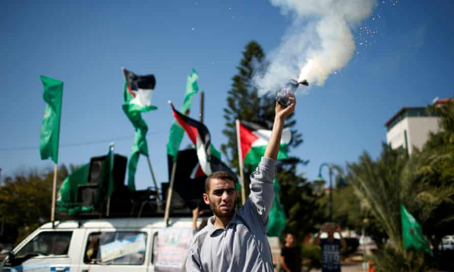 A Palestinian man releases fireworks in Gaza during celebrations after Hamas said it reached a deal with Palestinian rival Fatah.