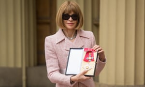 Anna Wintour poses for photos after being made a dame at Buckingham Palace.