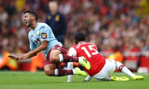 Ainsley Maitland-Niles slid in on Aston Villa's Neil Taylor to earn a red card.