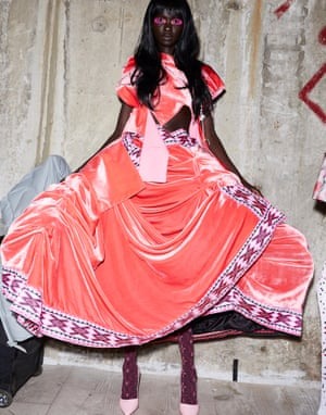 A model wearing a pink Matty Bovan dress at London Fashion Week autumn/winter 2020 catwalk collections.