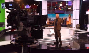 David Dimbleby stands in the middle of the BBC's election night 2017 set during rehearsals.