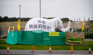 """An inflatable elephant with a message addressed to the Chinese president, Xi Jinping, saying that Hinkley Point nuclear power station would be """"a bad investment"""" for the Chinese state, is set up in an anti-nuclear campaign camp near the plant in Somerset."""