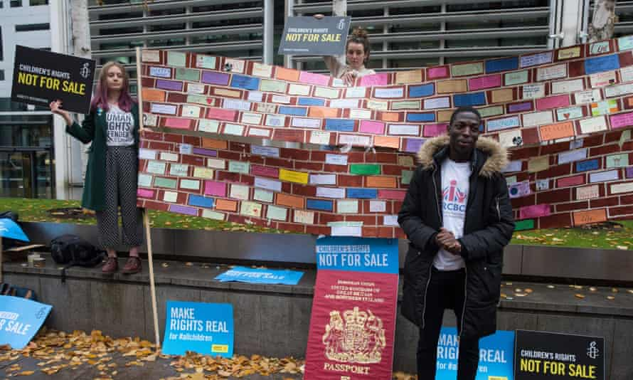 Campaigners from Amnesty International UK's Children's Human Rights Network and PRCBC outside the Home Office to call on the British Government to stop selling children's rights