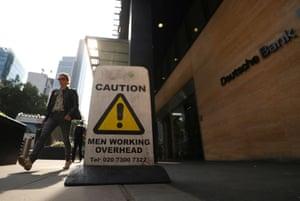 A pedestrian walks past a Deutsche Bank office in London, Britain July 8, 2019. REUTERS/Simon Dawson