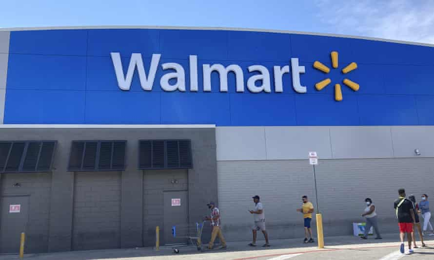 Customers wait in line outside a Walmart in Miami.