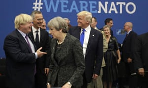 Boris Johnson, then foreign secretary (left), jokes with Donald Trump as Theresa May walks past during a Nato working dinner in May 2017