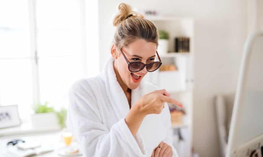 Woman smiling at herself in the mirror