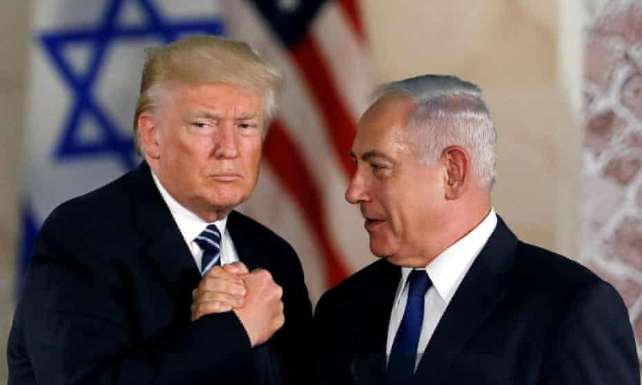Donald Trump and Benjamin Netanyahu shake hands after Trump's address at the Israel Museum in Jerusalem in May 2017.