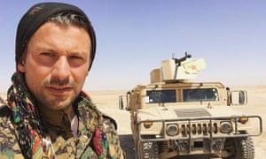 Mehmet Aksoy stands in front of a tank