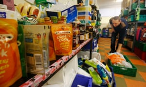 A volunteer prepares emergency food boxes.