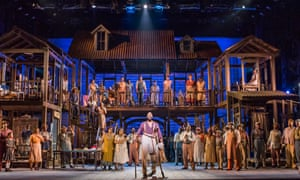 Eric Greene, centre, as Porgy, and the 40-strong chorus of Porgy and Bess at the Coliseum.