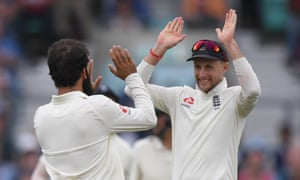 Joe Root and Moeen Ali celebrate the wicket of Rahane