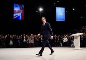 Manchester, UK Chancellor of the Exchequer George Osborne walks from the stage after delivering his keynote address to delegates on the second day of the annual Conservative party conference. Follow our live coverage