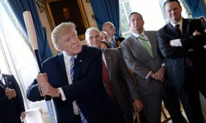 """President Donald Trump swings a Marucci baseball bat in the Blue Room during a """"Made in America"""" product showcase event at the White House in Washington, DC, on July 17, 2017. / AFP PHOTO / Olivier DoulieryOLIVIER DOULIERY/AFP/Getty Images"""