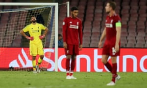 Liverpool goalkeeper Alisson Becker looks dejected after the 1st goal scored by Lorenzo Insigne of Napoli