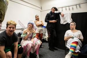 The cast relax after a performance