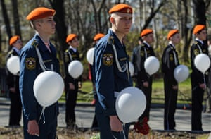 Military cadets with white balloons attend a time capsule ceremony honouring emergency workers