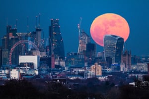 A blue 'supermoon' rises behind 20 Fenchurch Street, known as the Walkie-Talkie, in central London, January 2018