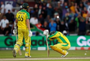 Australia's Nathan Lyon and Jason Behrendorff look dejected after losing the match.