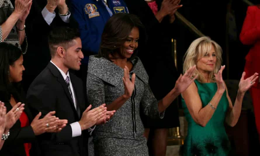 First lady Michelle Obama, centre, applauds during the 2015 State of the Union address. This time a seat in her guest box will be left empty to represent the victims of gun violence.