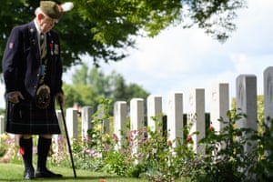Veteran John Lamont in Bayeux cemetery, Normandy, on the D-day anniversary on 6 June, 2019.