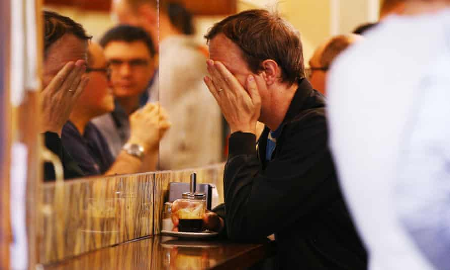 People pay their respects to Sisto Malaspina while drinking a long black coffee inside Pellegrini's on Tuesday.