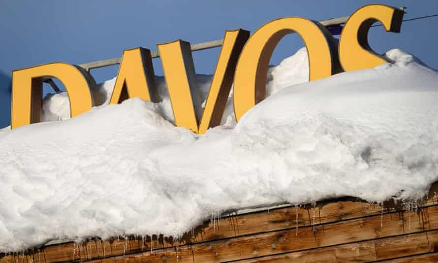 Letters covered in snow reading Davos are pictured on the rooftop of a hotel, near the Congress Centre in Davos, eastern Switzerland