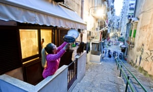 Residents of Quartieri Spagnoli, Naples, sing together from their balconies during lockdown in March 2020.