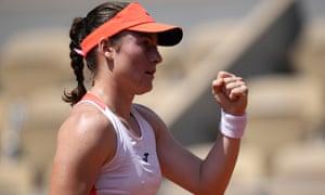 Slovenia's Tamara Zidansek celebrates after winning the first set.
