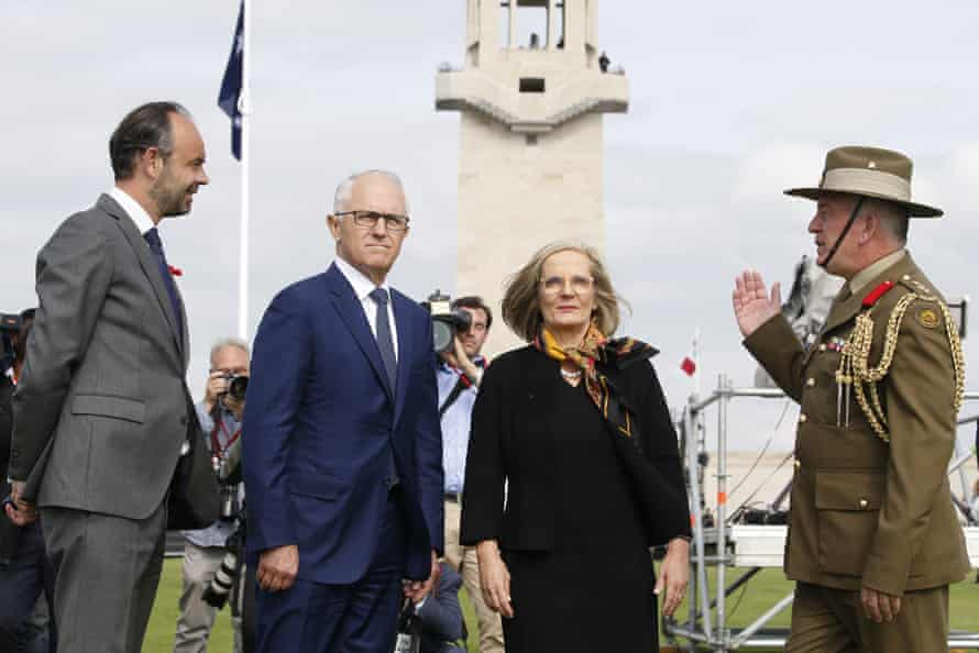 Australian Colonel Scott Clingan (right) escorts French prime minister Édouard Philippe (left) as well as Malcolm and Lucy Turnbull at the military cemetery before they visit the Sir John Monash Centre.