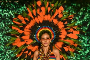 A model presents a creation by the Colombian designer Eduard Zapata made with organic elements during the BioFashion Show