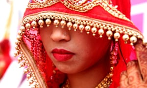 An Indian bride takes part in a mass marriage ceremony on the occasion of the Akshaya Tritiya festival in Bhopal, India.