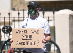 A protester outside Dominic Cummings's north London home last week.