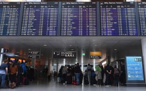 Passengers wait in line at counters of the German airline Lufthansa at the Franz-Josef-Strauss airport in Munich, southern Germany,.