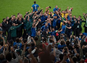 The Italy players and squad celebrate in front of their fans.