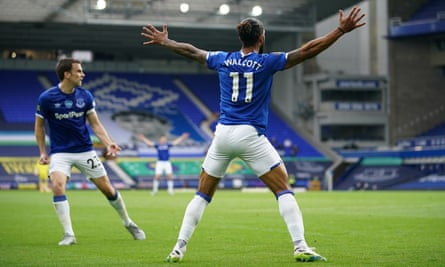 Theo Walcott celebrates after scoring an 87th-minute equaliser for Everton against Aston Villa