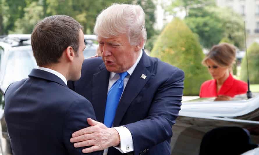 President Emmanuel Macron greets President Donald Trump at Les Invalides museum in Paris