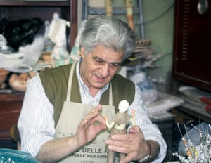 The papier mache model makerThe man is working on a papier mach mannequin in a small workshop in Puglia, Italy.