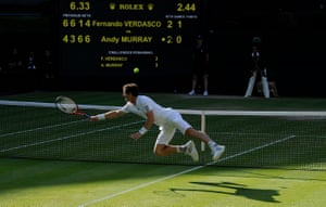 Andy Murray dives to win a point