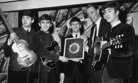 The Beatles collecting a silver award.